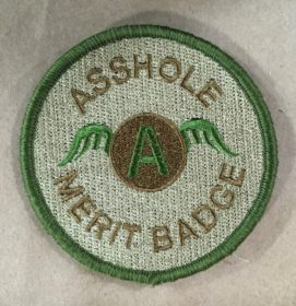 asshole merit badge green patch